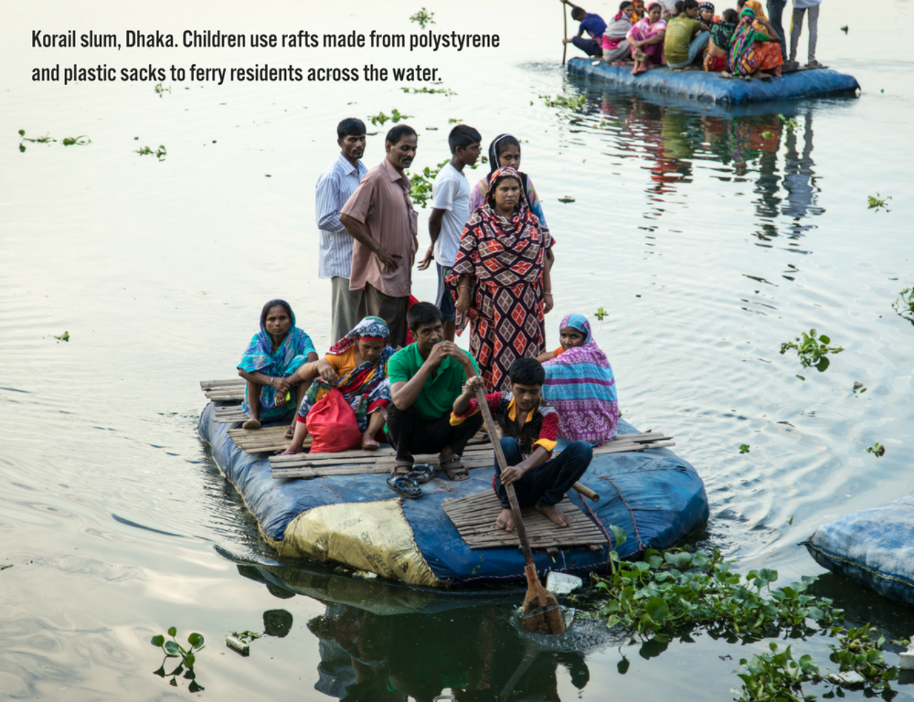 Korail Slum Dhaka  Children Use Rafts Made From Polystyrene And Plastic Sacks To Ferry Residents Across The Water