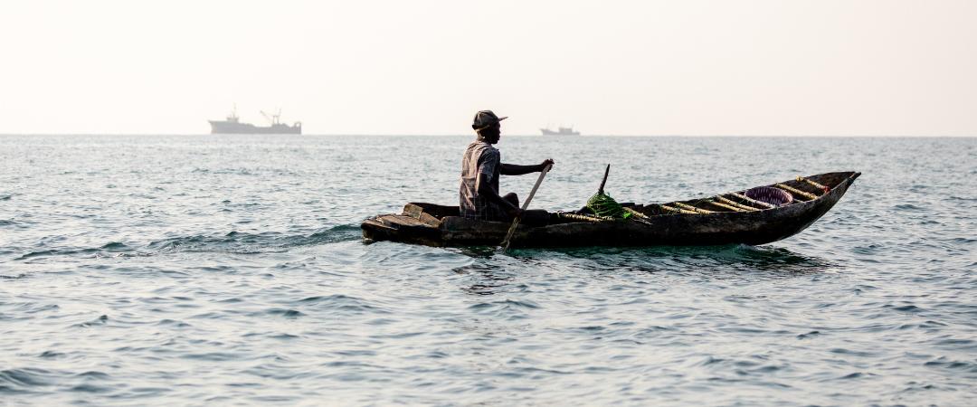 Man on a fishing canoe